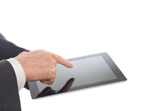 Senior hands with tablet PC Stock Image