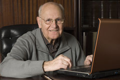 Senior handsome man on laptop. In his desk Stock Photo