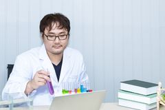 Senior handsome researcher working overtime and strain near lab royalty free stock photography