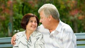 Senior happy couple in park Stock Image