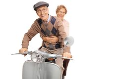 Senior happy couple riding a vintage motorbike stock image