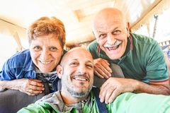 Senior happy couple with son taking selfie at bus trip in Laos stock images