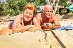 Senior happy couple taking selfie with stick in Thailand trip Royalty Free Stock Photography