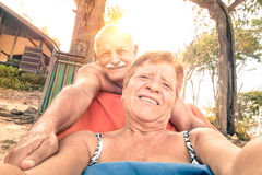 Senior happy couple taking selfie in Thailand trip Royalty Free Stock Image