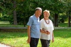 Senior happy couple walking Stock Photo
