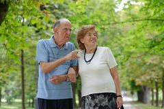 Senior happy couple walking Royalty Free Stock Images