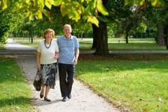 Senior happy couple walking Royalty Free Stock Images