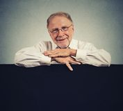 Senior happy man with blank space white banner Stock Photos