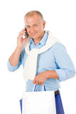 Senior happy man holding shopping bags stock images