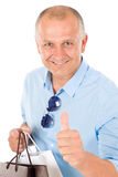Senior happy man shopping thumb up Royalty Free Stock Photography