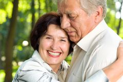 Senior happy smiling couple. Walking together outdoors stock photography