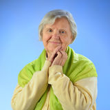 Senior happy woman with grey hairs. Royalty Free Stock Image