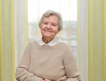 Senior happy woman in her home. Stock Image