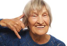 Senior happy woman is making a call me gesture Stock Photo