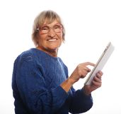 Senior happy woman using ipad Stock Images