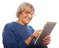 Senior happy woman using ipad Stock Photo