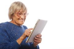 Senior happy woman using ipad Stock Photos