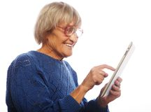Senior happy woman using ipad Stock Images