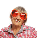 Senior happy woman wearing big sunglasses Royalty Free Stock Photo
