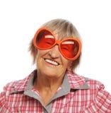 Senior happy woman wearing big sunglasses Royalty Free Stock Photo