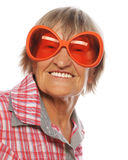 Senior happy woman wearing big sunglasses doing funky action Royalty Free Stock Photo