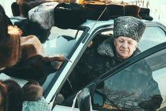 Senior in hat. ZABOLOTTIA, UKRAINE - 20 January 2009: Man in papakha at local market in winter Royalty Free Stock Photos