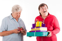 Senior have only one gift, daughter with a lot Stock Image