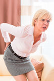 Senior having back pain at home Royalty Free Stock Photos