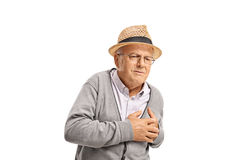 Senior having a heart attack Royalty Free Stock Images
