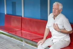 Senior having pain in chest Royalty Free Stock Image