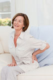 Senior having a pain at home Stock Images