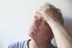 Senior with head pain Royalty Free Stock Photography