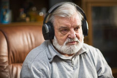 Senior with Headphones Royalty Free Stock Photo