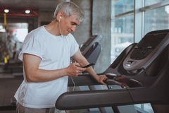 Senior man working out at the gym royalty free stock images
