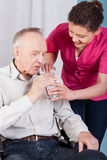 Senior and helpful nurse Royalty Free Stock Photo