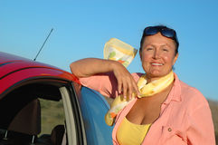 Senior with hew new car. Attractive older woman with her brand new car Stock Photography
