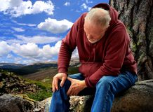 Senior Hiker. An Active Senior Hiking with Joint Pain royalty free stock image