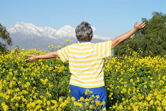Senior hiker. Active senior woman excitedly hiking through a beatuful patch of land Royalty Free Stock Photo