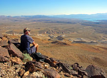 Senior hiker enjoying view of Lake Mead, Nevada. Royalty Free Stock Images