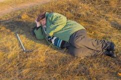Senior hiker has short rest lying on the roadside Royalty Free Stock Photos