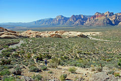 Senior hikers ascending Turtlehead Peak in Red Rock Canyon, NV Stock Photo