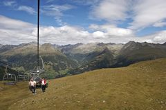 Senior hikers on cable railway Stock Photos
