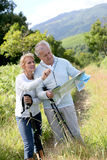 Senior hikers with map in countryside Royalty Free Stock Images