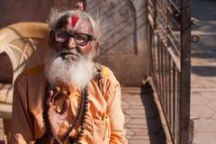 Senior hindu man with vintage glasses Stock Image