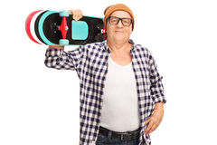 Senior hipster holding a skateboard Stock Photography