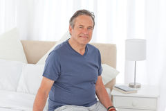 Senior on his bed Stock Photography