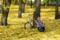 Senior and his bicycle in autumn park. Stock Image