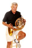 Senior with his French Horn Royalty Free Stock Photography