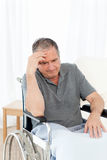 Senior in his wheelchair having a headache Stock Photography