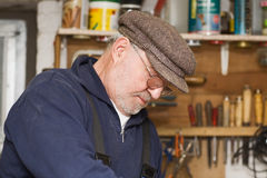 Senior in his workshop Stock Photography
